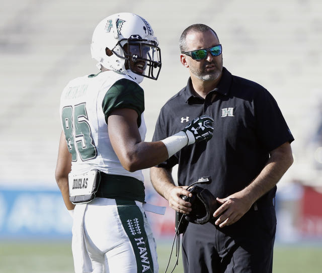 Hawaii wide receiver Marcus Armstrong-Brown, left, talks with head coach Nick Rolovich during the second half of an NCAA college football game against UCLA in Pasadena, Calif., Saturday, Sept. 9, 2017. UCLA won 56-23. (AP Photo/Alex Gallardo)