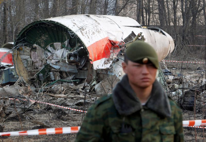 FILE PHOTO: Russian serviceman stands guard near part of the wreckage of a Polish government Tupolev Tu-154 aircraft that crashed near Smolensk airport