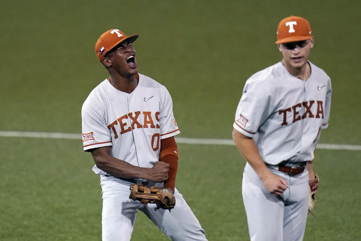 Texas' Trey Faltine (0) and Mitchell Daly (19) celebrate after turning a double play against South Florida to end the eighth inning in an NCAA Super Regional college baseball game, Sunday, June 13, 2021, in Austin, Texas. (AP Photo/Eric Gay)