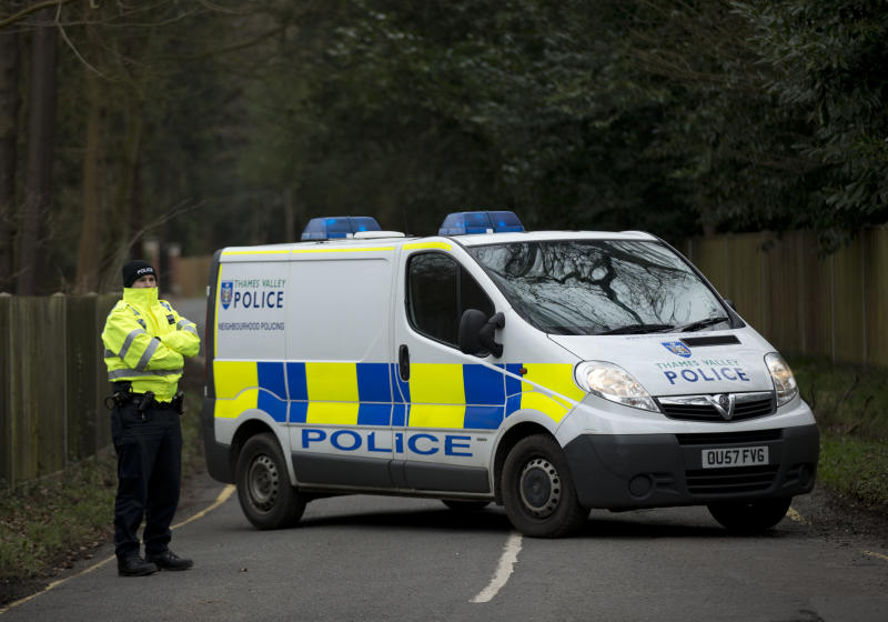 A British police officer stands guard by a cordoned off road leading to the residence of Boris Berezovsky near Ascot, a town 40 kilometers (25 miles) west of London, Monday, March 25, 2013. There was no evidence to suggest anyone else was involved in the death of Boris Berezovsky, the self-exiled Russian tycoon who went from Kremlin kingmaker to fiery critic, British police said Sunday. With an investigation under way, police are treating the death of Berezovsky — who fled to Britain in the early 2000s after a bitter falling out with Russian President Vladimir Putin — as unexplained. But the former oligarch survived assassination attempts and recently faced financial difficulties, prompting speculation as to whether his death was part of a conspiracy — or suicide. (AP Photo/Matt Dunham)