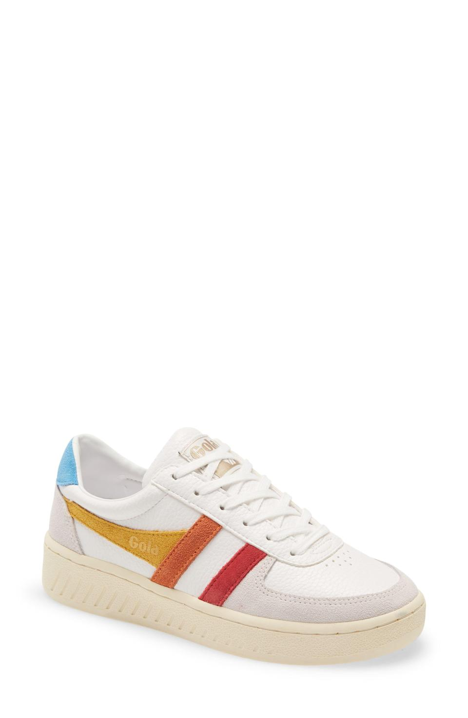 """<p><strong>GOLA</strong></p><p>nordstrom.com</p><p><strong>$100.00</strong></p><p><a href=""""https://go.redirectingat.com?id=74968X1596630&url=https%3A%2F%2Fwww.nordstrom.com%2Fs%2Fgola-classics-grandslam-trident-sneaker-women%2F5786896&sref=https%3A%2F%2Fwww.cosmopolitan.com%2Fstyle-beauty%2Ffashion%2Fg35017315%2F2021-shoe-trends%2F"""" rel=""""nofollow noopener"""" target=""""_blank"""" data-ylk=""""slk:Shop Now"""" class=""""link rapid-noclick-resp"""">Shop Now</a></p><p>These tri-colored ones from Gola are just so fun! </p>"""