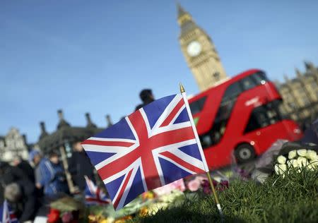 Tributes are seen in Parliament Square following a recent attack in Westminster, London