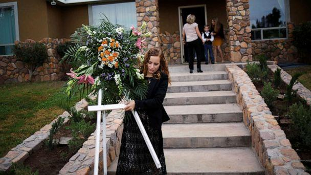 PHOTO: A relative carries a wreath before the funeral of Dawna Ray Langford and her two children, members of the Mexican-American Mormon community killed by unknown assailants, in La Mora, Sonora state, Mexico, Nov. 7, 2019. (Jose Luis Gonzalez/Reuters)