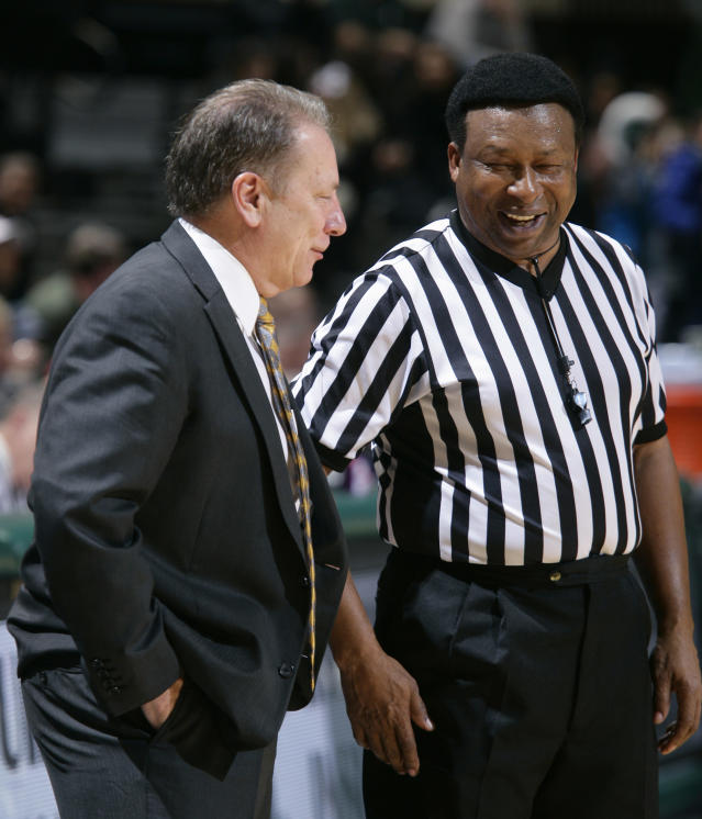 Michigan State coach Tom Izzo, left, talks with official Ed Hightower during the second half of an NCAA college basketball game against North Florida, Tuesday, Dec. 17, 2013, in East Lansing, Mich. Hightower was working his final game at Michigan State. Michigan State won 78-48. (AP Photo/Al Goldis)