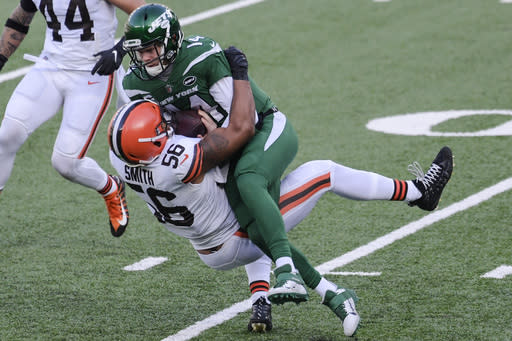 Cleveland Browns' Malcolm Smith (56) tackles New York Jets quarterback Sam Darnold (14) during the first half of an NFL football game Sunday, Dec. 27, 2020, in East Rutherford, N.J. (AP Photo/Bill Kostroun)