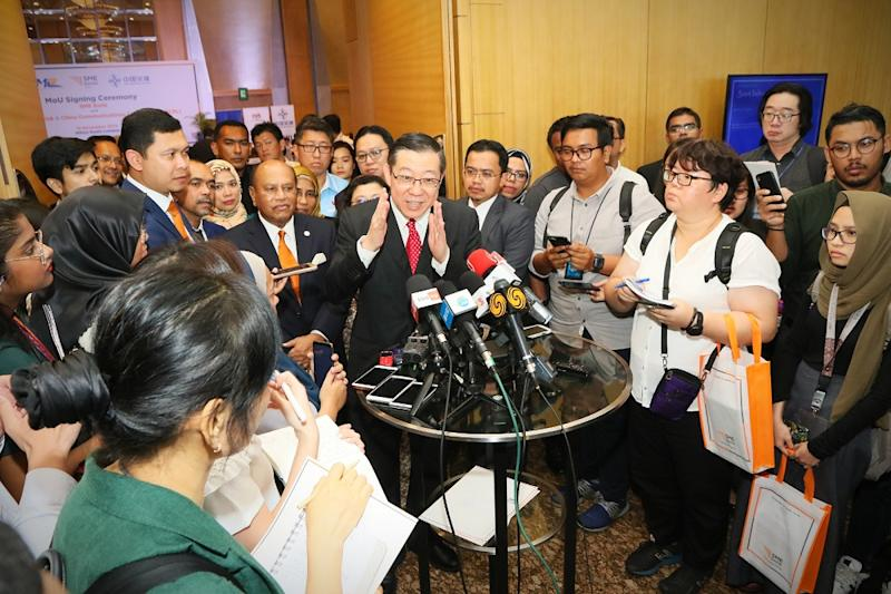 Finance Minister Lim Guan Eng speaks to reporters after the MoU signing ceremony between SME bank, MRL and CCC-ECRL in Kuala Lumpur November 18, 2019.