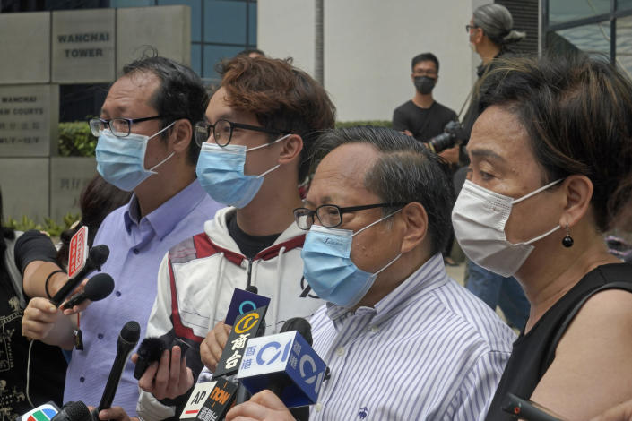 """Various defendants including pro-democracy activists, from left, Richard Tsoi, Figo Chan and Albert Ho speak to media outside a court in Hong Kong, Monday, May 17, 2021. Trial starts for Jimmy Lai and nine others, accused of """"incitement to knowingly take part in an unauthorized assembly"""" for a protest march on Oct. 1, 2019. The court has estimated 10 days for this trial. (AP Photo/Kin Cheung)"""