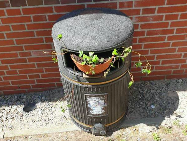 The bin taken up permanent residency on the German island of Borkum after being transformed into a plant holder. (PA)