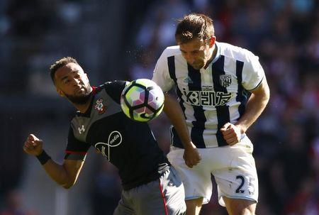Britain Football Soccer - West Bromwich Albion v Southampton - Premier League - The Hawthorns - 8/4/17 West Bromwich Albion's Craig Dawson in action with Southampton's Nathan Redmond Action Images via Reuters / Peter Cziborra Livepic