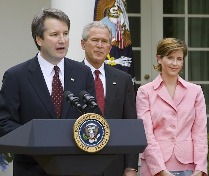 Brett Kavanaugh with then-President George W. Bush and wife Ashley Kavanaugh in June 2006. (Photo: PAUL J. RICHARDS via Getty Images)