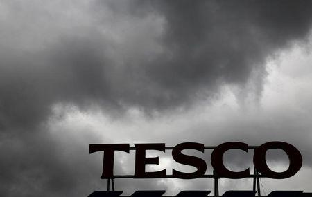Grey clouds hang over a Tesco Extra store in New Malden in southwest London, Britain June 4, 2014. REUTERS/Luke MacGregor/File Photo