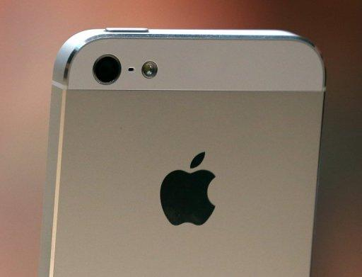 The new iPhone 5 is displayed during an Apple special event. Apple's iPhone 5 is one of the biggest product launches ever in the sector, and may also deliver a well-timed stimulus to the US economy ahead of the presidential election, analysts say