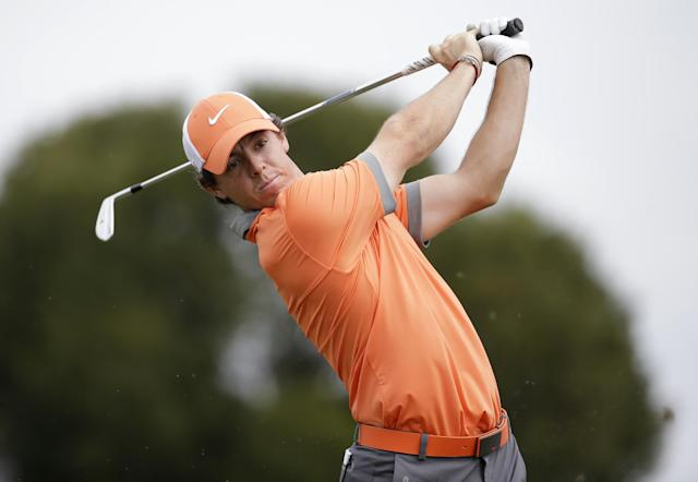 Rory McIlroy of Northern Ireland tees off on the fifth hole during the first round of the Honda Classic golf tournament, Thursday, Feb. 27, 2014, in Palm Beach Gardens, Fla. (AP Photo/Lynne Sladky)