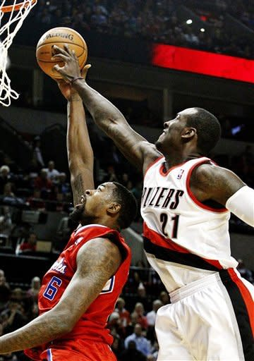 Portland Trail Blazers center J.J. Hickson (21) blocks a shot attempt by Los Angeles Clippers center DeAndre Jordan during the first quarter of their NBA basketball game in Portland, Ore., Thursday, Nov. 8, 2012. (AP Photo/Don Ryan)