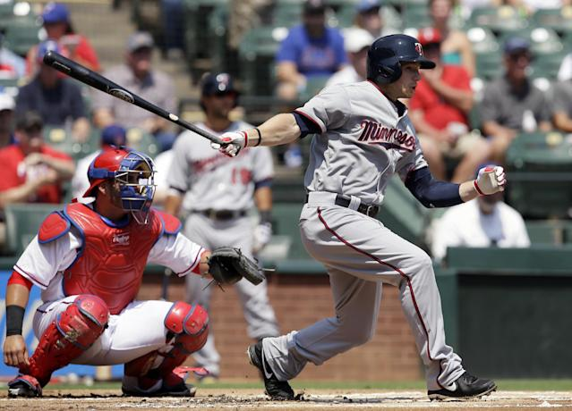 Minnesota Twins' Alex Presley follows through on a single to right as Texas Rangers' Geovany Soto watches in the first inning of a baseball game, Sunday, Sept. 1, 2013, in Arlington, Texas. The hit was Presley's first as a member of the Twins organization. (AP Photo/Tony Gutierrez)