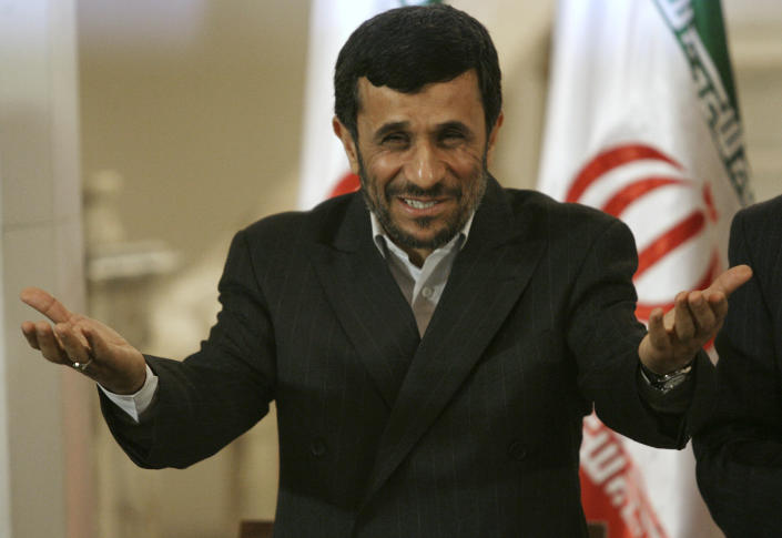 FILE - In this Sunday, March 2, 2008, file photo, Iranian President Mahmoud Ahmadinejad reacts during a press conference in Baghdad, Iraq. Iran has played many political roles in Baghdad since the fall of Saddam Hussein: spoiler to American-crafted administrations, haven for Iraqi political outcasts and big brother to Prime Minister Nouri al-Maliki's Shiite-led government. (AP Photo/Hadi Mizban, File)