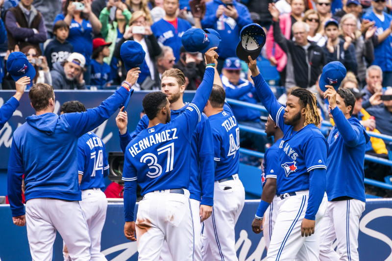TORONTO, ONTARIO - SEPTEMBER 29: Vladimir Guerrero Jr. #27 of the Toronto Blue Jays and teammates salute the crowd during the last game of the season against the Tampa Bay Rays in the third inning during their MLB game at the Rogers Centre on September 29, 2019 in Toronto, Canada. (Photo by Mark Blinch/Getty Images)