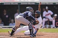 Cleveland Indians' Amed Rosario, right, scores as Tampa Bay Rays catcher Francisco Mejia waits for the ball in the eighth inning of a baseball game, Sunday, July 25, 2021, in Cleveland. (AP Photo/Tony Dejak)