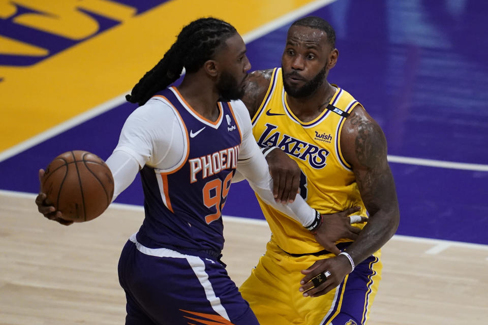 Los Angeles Lakers forward LeBron James (23) defends against Phoenix Suns forward Jae Crowder (99) during the second quarter of Game 6 of an NBA basketball first-round playoff series Thursday, Jun 3, 2021, in Los Angeles. (AP Photo/Ashley Landis)