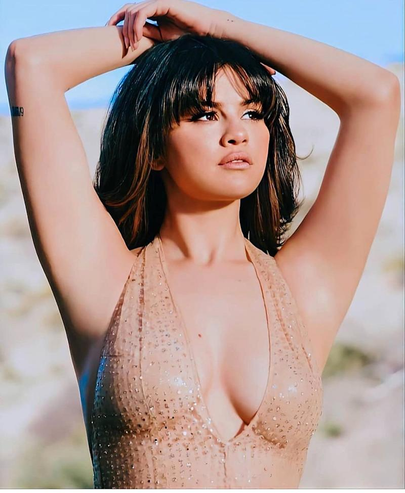 Selena Gomez poses in a nude-colored top