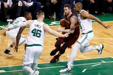 May 15, 2018; Boston, MA, USA; Cleveland Cavaliers center Kevin Love (0) drives against Boston Celtics forward Al Horford (42) and center Aron Baynes (46) during the third quarter of game two of the Eastern conference finals of the 2018 NBA Playoffs at TD Garden. Mandatory Credit: Greg M. Cooper-USA TODAY Sports