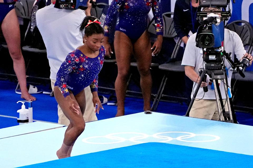 Simone Biles bounces off the carpet on floor exercise during qualifying Sunday in Tokyo.