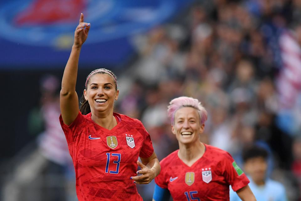 REIMS, FRANCE - JUNE 11: Alex Morgan of the USA celebrates after scoring her team's first goal during the 2019 FIFA Women's World Cup France group F match between USA and Thailand at Stade Auguste Delaune on June 11, 2019 in Reims, France. (Photo by Alex Caparros - FIFA/FIFA via Getty Images)