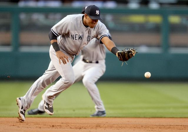 New York Yankees third baseman Yangervis Solarte chases the single by Los Angeles Angels' Albert Pujols in the first inning of a baseball game in Anaheim, Calif., Tuesday, May 6, 2014. (AP Photo/Jayne Kamin-Oncea)