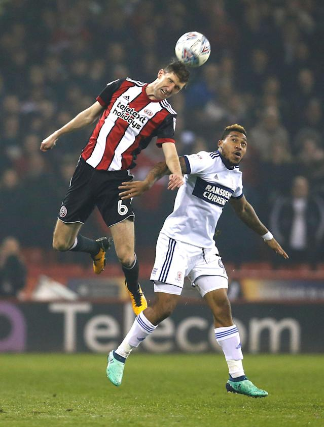 "Soccer Football - Championship - Sheffield United vs Middlesbrough - Bramall Lane, Sheffield, Britain - April 10, 2018 Sheffield United's Chris Basham in action with Middlesbrough's Britt Assombalonga in action Action Images/Ed Sykes EDITORIAL USE ONLY. No use with unauthorized audio, video, data, fixture lists, club/league logos or ""live"" services. Online in-match use limited to 75 images, no video emulation. No use in betting, games or single club/league/player publications. Please contact your account representative for further details."