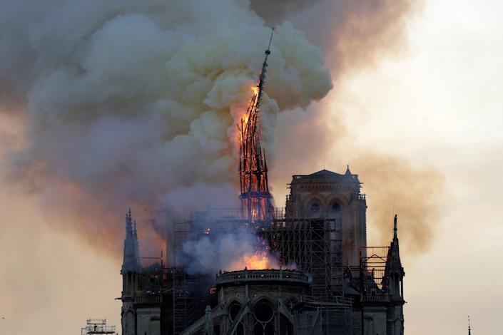 The steeple of the landmark Notre-Dame Cathedral collapses as the cathedral is engulfed in flames in central Paris on April 15, 2019. (Photo: Geoffroy Van Der Hasselt/AFP/Getty Images)