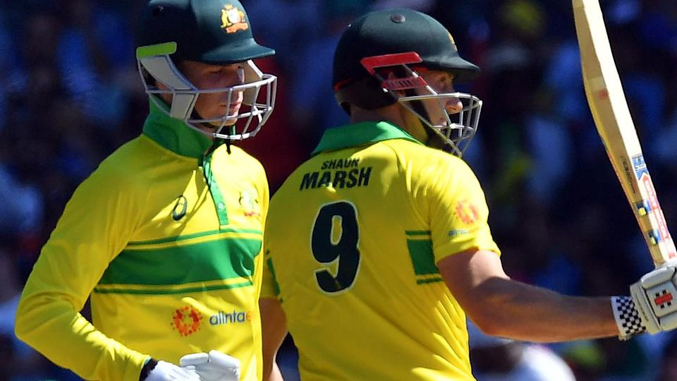 Peter Handscomb and Shaun Marsh both made half-centuries. (Photo by SAEED KHAN/AFP/Getty Images)
