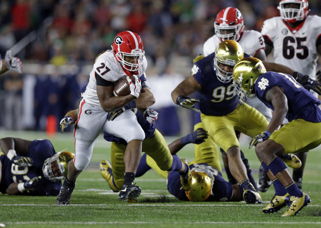 "Georgia running back <a class=""link rapid-noclick-resp"" href=""/ncaaf/players/239216/"" data-ylk=""slk:Nick Chubb"">Nick Chubb</a> (27) carries against Notre Dame during the first half of an NCAA college football game in South Bend, Ind., Saturday, Sept. 9, 2017. (AP Photo/Michael Conroy)"