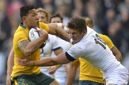 FILE PHOTO: Australia's Israel Folou (L) fends off the challenge of England's Owen Farrell during their international rugby union test match at Twickenham in London, November 2, 2013. REUTERS/Toby Melville