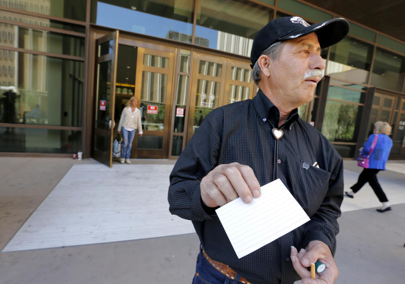 "R.D. Williams, of Amarillo, Texas., shows his blank lottery ticket outside the Maricopa County Superior Court, Thursday, May 2, 2013 in Phoenix that denied him a seat in the in spectator gallery of the Jodi Arias murder trial. Williams said that only court-issued cards with an ""X"" marked on them were allowed a seat inside the courtroom. Williams drove 12 hours from Texas and arrived at the court at 3 a.m. in an attempt to see the trial. The prosecutor in Arias' murder trial presents closing arguments Thursday in a case that has captured headlines worldwide with lurid tales of sex, lies and a bloody killing. Arias faces a potential death sentence if convicted of first-degree murder in the June 2008 killing of her one-time boyfriend in his suburban Phoenix home. (AP Photo/Matt York)"