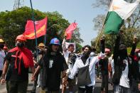 Demonstrators rally against the military coup at the University of Yangon
