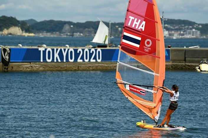 A competitor from Thailand heads out on her windsurfer board to practise ahead of the Tokyo 2020 Olympic Games sailing competition at Enoshima Yacht Harbour in Fujisawa, Kanagawa Prefecture