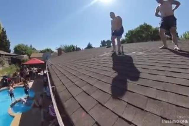 Guy Trying to Jump off Roof into Pool Slips and Falls to Ground