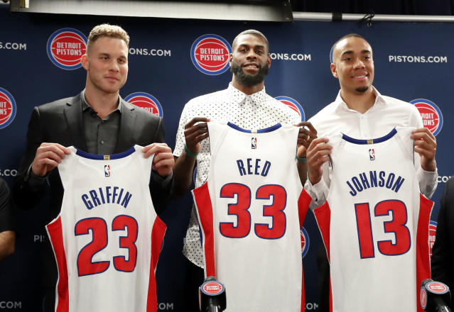 Blake Griffin, from left, Willie Reed and Brice Johnson pose with their new Detroit Pistons uniforms. (AP)