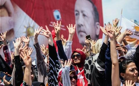 Mr Erdogan is popular with many Turks but has polarized the country - Credit: Berk Ozkan/Anadolu Agency/Getty Images