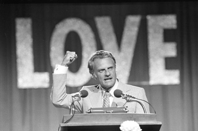 "<p>Billy Graham addresses 18,000 messengers in Dallas, June 13, 1974, on the closing night of the Southern Baptist Convention. The theme of the convention was ""Share His Love Now,"" and he asked the messengers to become ""firebrands"" for Christ, offering the gospel of Christ as the hope for the world. (Photo: AP) </p>"