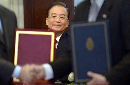 China's Prime Minister Wen Jiabao is seen while Chinese and Argentine ministers exchange documents
