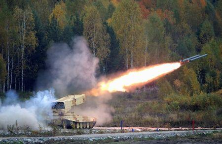 """A Russian """"TOS-1 Buratino"""" multiple rocket launcher fires during the """"Russia Arms Expo 2013"""" 9th international exhibition of arms, military equipment and ammunition, in the Urals city of Nizhny Tagil, September 25, 2013. REUTERS/Sergei Karpukhin"""