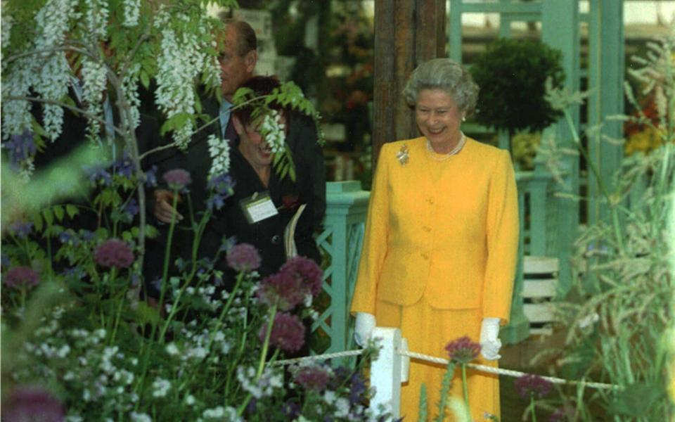 The Queen looks around exhibits at the Chelsea Flower Show in 1994 - PA