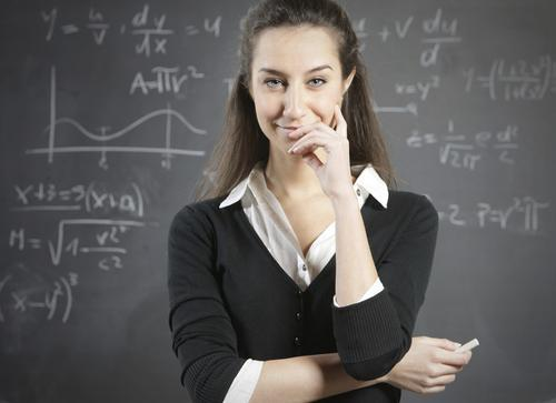 Teacher in front of a blackboard