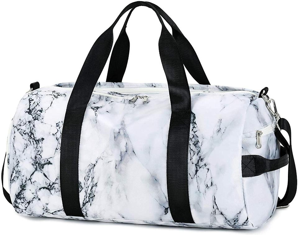 <p>This <span>Sport Gym Duffle Travel Bag</span> ($33) has a shoe compartment, a wet pocket, and has several other pockets of varying sizes to organize your gear.</p>