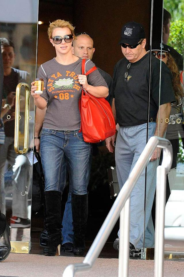 "Britney Spears and her father, Jamie, leave their hotel in Adelaide, Australia, to travel back home after a monthlong Down Under tour. <a href=""http://www.pacificcoastnews.com/"" target=""new"">PacificCoastNews.com</a> - November 30, 2009"