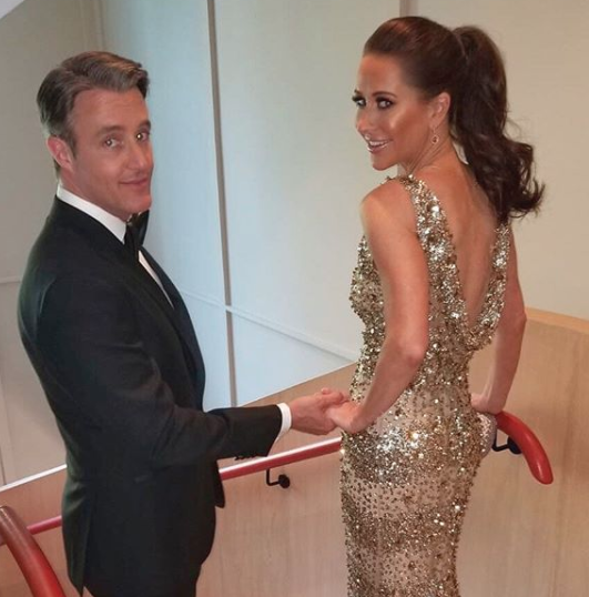 Ben and Jessica Mulroney prepare to leave for the intimate royal wedding reception at Frogmore House. Jessica is wearing a gown by Naeem Kahn.