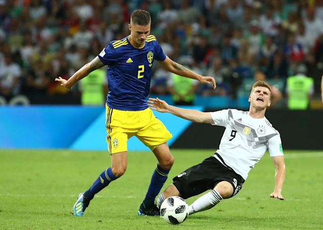 Soccer Football - World Cup - Group F - Germany vs Sweden - Fisht Stadium, Sochi, Russia - June 23, 2018 Germany's Timo Werner in action with Sweden's Mikael Lustig REUTERS/Michael Dalder