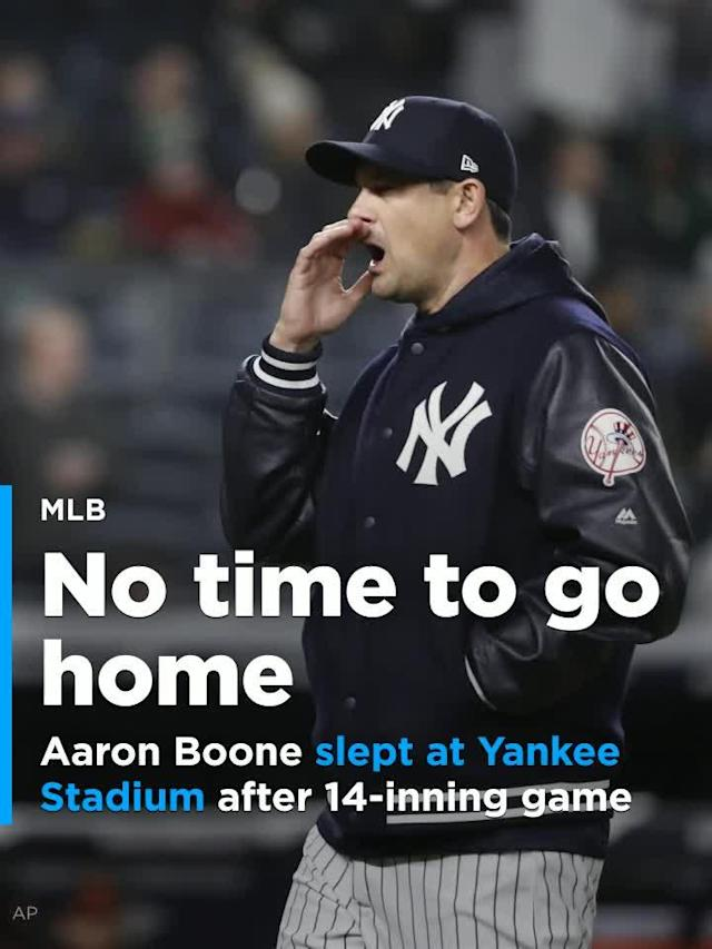 New York Yankees manager Aaron Boone slept at Yankee Stadium after the team's 14-inning loss to the Baltimore Orioles.