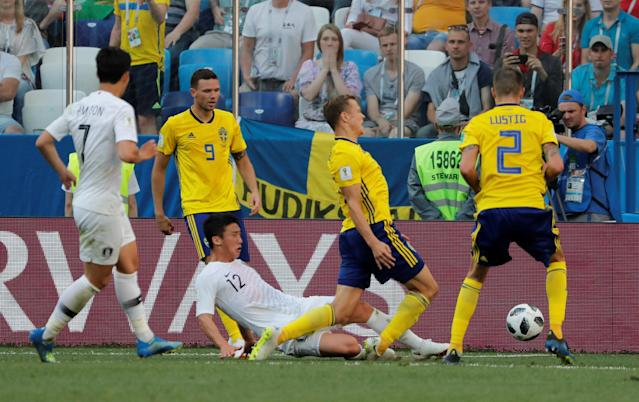 Soccer Football - World Cup - Group F - Sweden vs South Korea - Nizhny Novgorod Stadium, Nizhny Novgorod, Russia - June 18, 2018 South Korea's Kim Min-woo fouls Sweden's Viktor Claesson in the penalty area REUTERS/Carlos Barria